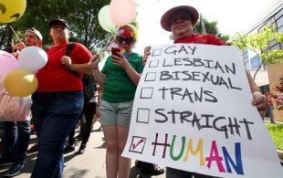 epa05376762 Supporters and members of the LGBT (lesbian, gay, bisexual, and transgender) community take part in a Gay Pride march in Guadalajara, Mexico, 18 June 2016. Hundreds of demonstrators showed slogans in favor of sexual diversity, against discrimination, and in solidarity for the victims of the recent mass shooting attack at Pulse nightclub in Orlando, Florida, USA, where 50 people, including the suspected gunman, were killed and 53 others were injured in the early hours of 12 June.  EPA/ULISES RUIZ BASURTO